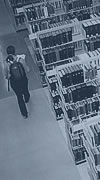 Photograph: Student walking in Gardner Stacks, Doe Library