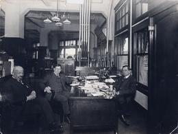 Richard N. and Rhoda H. Goldman papers, 1863-2003 (bulk 1939-1995)., Haas and 2 men sitting around desk in office. BANC MSS 2010/687 carton 48:01