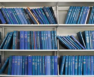 Bound oral history transcripts on shelves