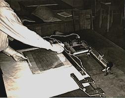 heat sealing Vinylite frame to protect papyrus, 1940