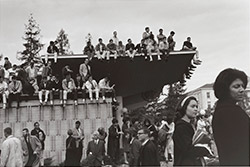 Photo of students sitting on roof of Golden Bear Center during rally, December 1964