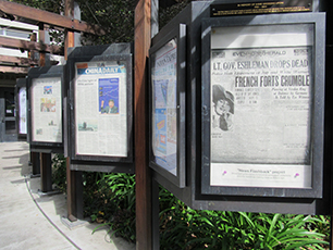 Newspaper front pages on display outside Moffitt Library